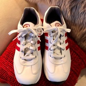 Adidas golf shoes in white with red stripes